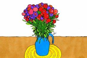 vaso de flor em cima da mesa